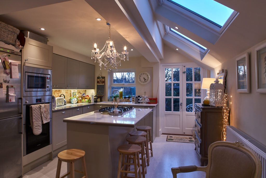 a modern family kitchen with a mixture of lighting