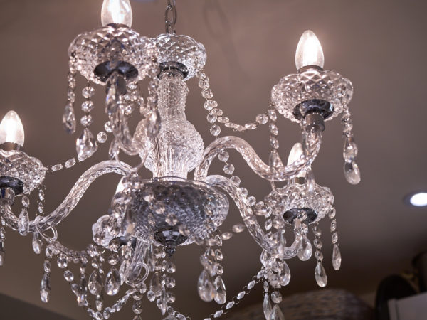 closeup of a lit chandelier in a kitchen